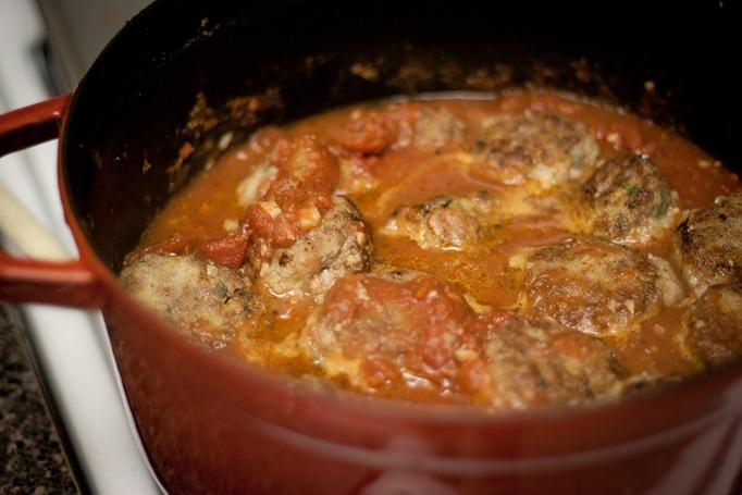 meatballs braising in tomato sauce