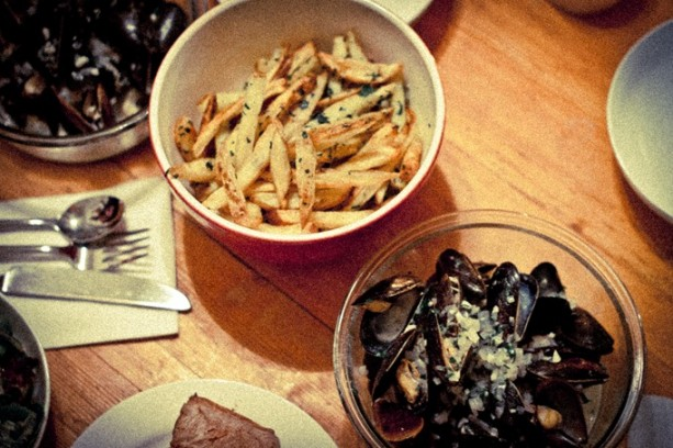Classic Moules-Frites - traditional preparation of mussels cooked in white wine, shallots, garlic, and butter, and served with homemade fries.