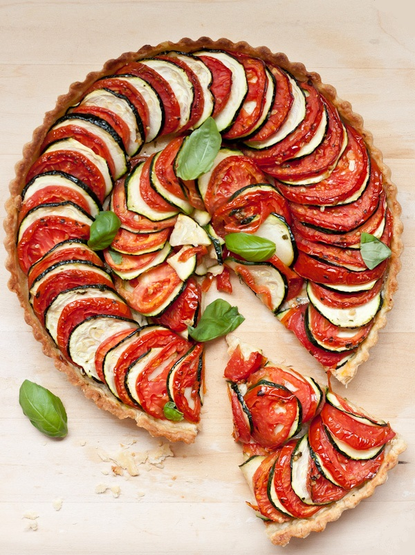 Tomato Zucchini Tart. A beautiful, SIMPLE layered vegetable tart for summer! You'll never guess how easy this is.