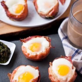 Prosciutto Egg Cups with Basil Pesto | bloggingoverthyme.com