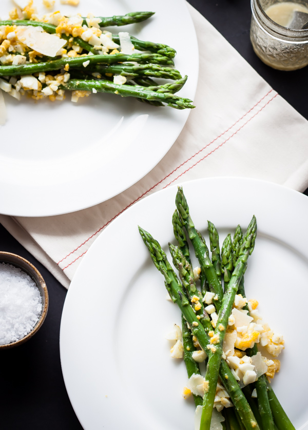Asparagus Mimosa Spring Salad. Steamed asparagus topped with chopped hard-boiled eggs, parmesan, and homemade lemon Dijon vinaigrette!