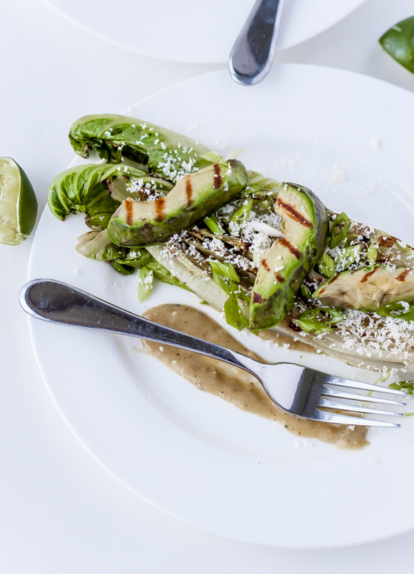 Burnt Romaine with Grilled Avocado, Tomatillos, and Cotija Cheese. Summer salads just got more interesting!
