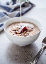 Broken Farro Porridge with Coconut Milk, Almonds, & Roasted Plums
