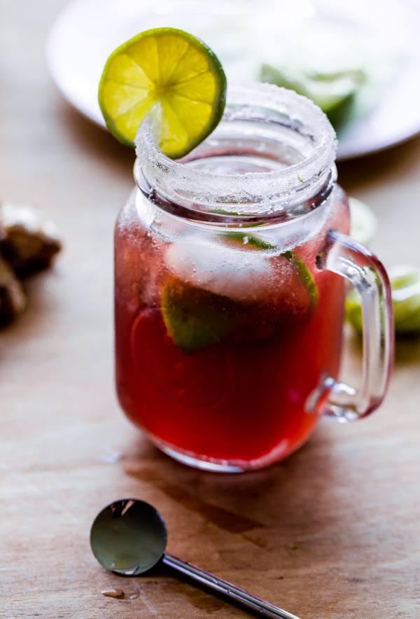 Pomegranate Moscow Mule. An easy fall cocktail made with pure pomegranate juice, ginger beer, and lime juice! #fall #cocktail #pomegranate