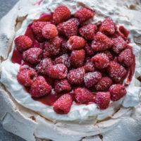 Fresh Raspberry Curd and Vanilla Whipped Cream Pavlova