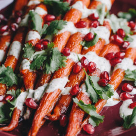 Roasted Carrots with Green-Tahini Sauce and Pomegranate