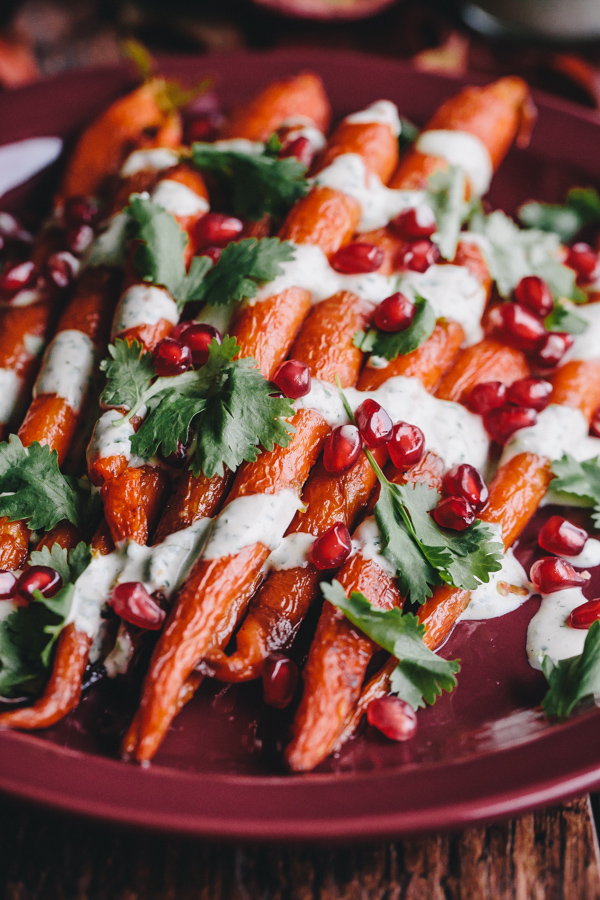 Roasted Carrots with Green Tahini Sauce and Pomegranate. A beautiful and healthy dairy and gluten-free side dish for fall and winter!
