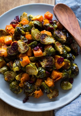 Roasted Brussels Sprouts and Squash with Dried Cranberries and Dijon Vinaigrette -- the perfect side dish for #Thanksgiving!