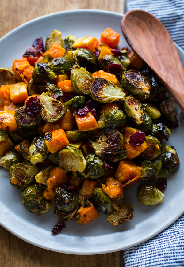 Roasted Brussels Sprouts And Squash With Dried Cranberries And Dijon Vinaigrette A Beautiful Plate