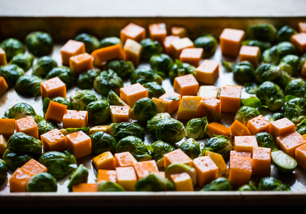 Chopped Brussels Sprouts and Butternut Squash on half sheet pan