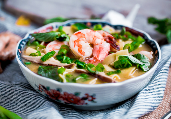 Simple and comforting Asian shrimp and noodle soup flavored with miso paste, shiitake mushrooms, and fresh ginger.