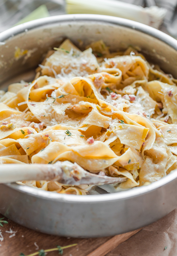 An easy recipe for rich and creamy leek and pancetta pappardelle pasta! Scaled down for two people.