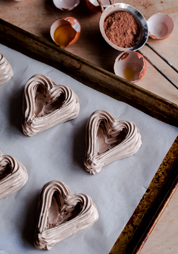Chocolate Heart Meringue Cups with Whipped Cream and Berries. An elegant, simple dessert for Valentine's Day!