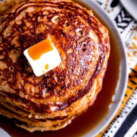 Light and fluffy whole wheat pancakes studded with lemon zest and chia seeds!