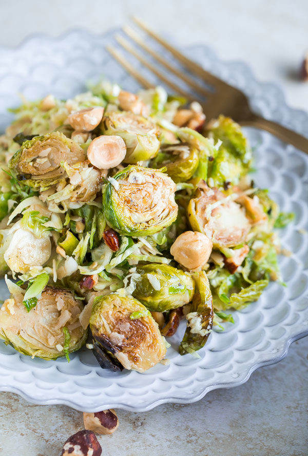 Brussels Sprouts Salad with Hazelnuts Parmesan and Pomegranate Molasses Vinaigrette