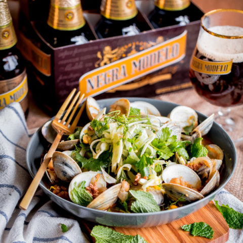 Clams and Chorizo with Shaved Fennel-Herb Salad . Clams steamed with Negra Modelo beer, a simple and impressive main course!