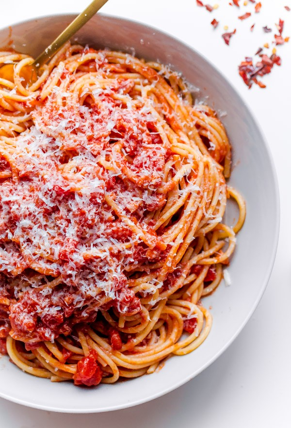 Classic Spaghetti All'Amatriciana. Homemade tomato sauce with pancetta, onion, garlic, and red pepper flakes!