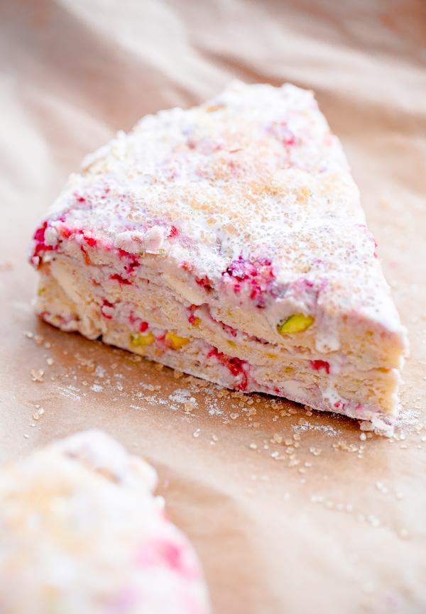 Raspberry Pistachio Scones with Lemon Glaze. So flaky and delicious!