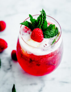 Sorbet Prosecco Floats with Muddled Raspberries and Fresh Mint