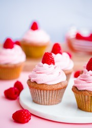 Roasted Raspberry Cupcakes from Grandbaby Cakes Cookbook! Raspberry cupcakes topped with naturally-colored raspberry buttercream!