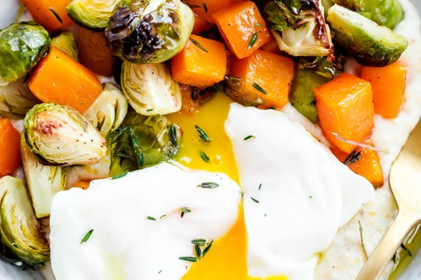 Creamy Goat Cheese Grits with Roasted Brussels Sprouts and Squash and Poached Eggs. A delicious, EASY vegetarian dinner recipe!
