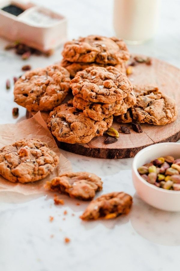 Chewy salted pistachio chocolate chunk cookie recipe infused with fresh orange zest!