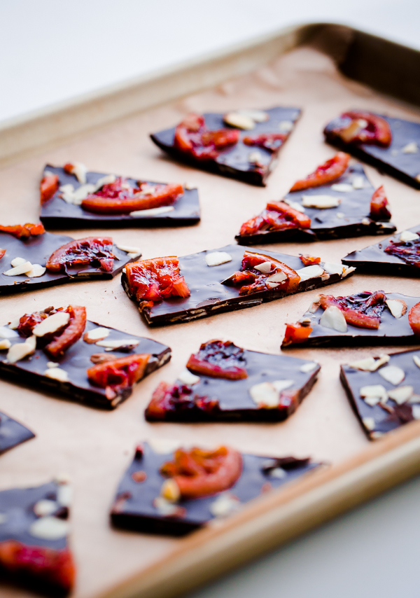 Homemade chocolate bark studded with candied blood orange and sliced almonds. This makes a beautiful edible gift during the holiday season!
