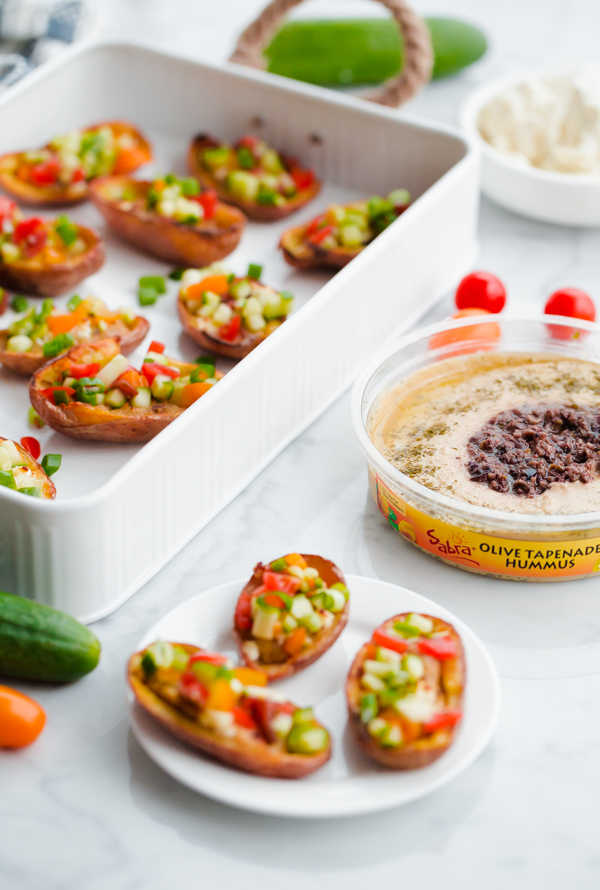 Greek-Style Potato Skins with Hummus. A HEALTHY and easy potato skin recipe made with hummus, feta, and chopped vegetables - a great party or tailgating appetizer!