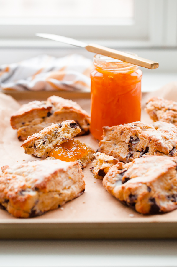 Orange chocolate chunk scones topped with a fresh orange glaze - this flaky cream scone recipe can be prepared in just over 30 minutes, or baked ahead of time!