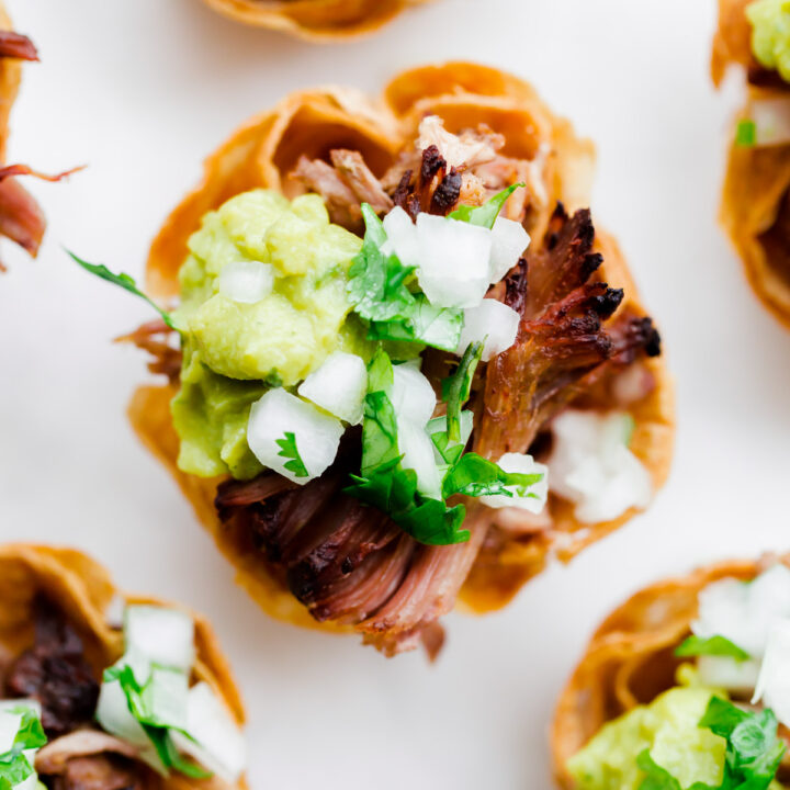 Slow Cooker Carnitas Taco Bites. Perfect for game day weekend!