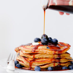 Blueberry Rye Pancakes with 2-Ingredient Molasses Syrup. Fluffy 100% whole grain pancakes filled with fresh blueberries!