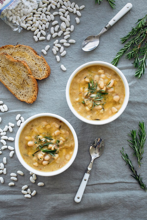 This hearty Slow Cooker Cannellini Bean Soup with Fresh Rosemary is packed with flavor, healthy protein and fiber, and only contains a handful of ingredients!