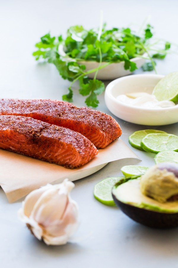 Brown Sugar and Chili-Rubbed Salmon with Avocado Crema. An easy, delicious healthy dinner that comes together in less than 30 minutes!
