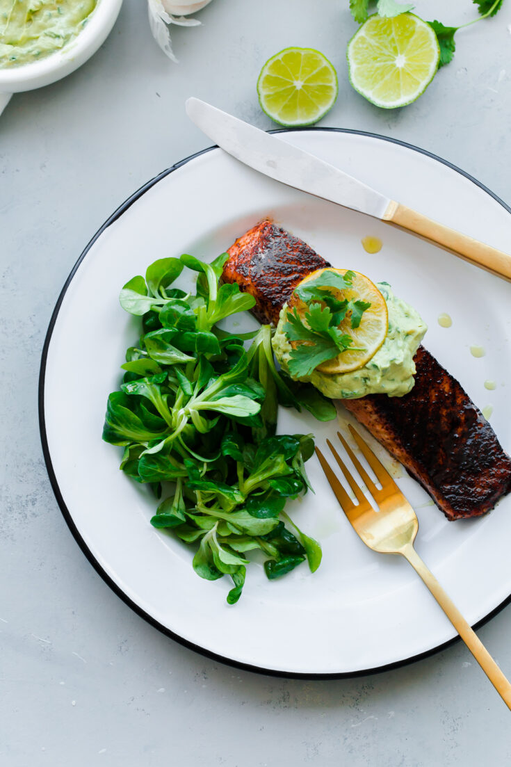 Brown Sugar and Chili Rubbed Salmon with Avocado Crema. An easy, delicious healthy dinner that comes together in less than 30 minutes!