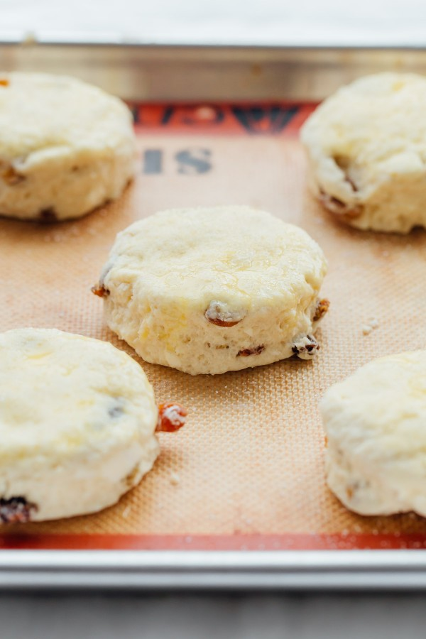 These Irish Soda Bread Scones are fluffy, lightly sweetened, filled with plump golden raisins, and pair perfectly with some butter and jam!