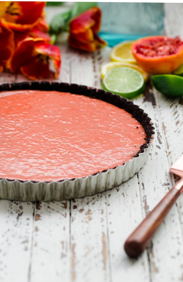 Triple citrus tart with chocolate crust and berries