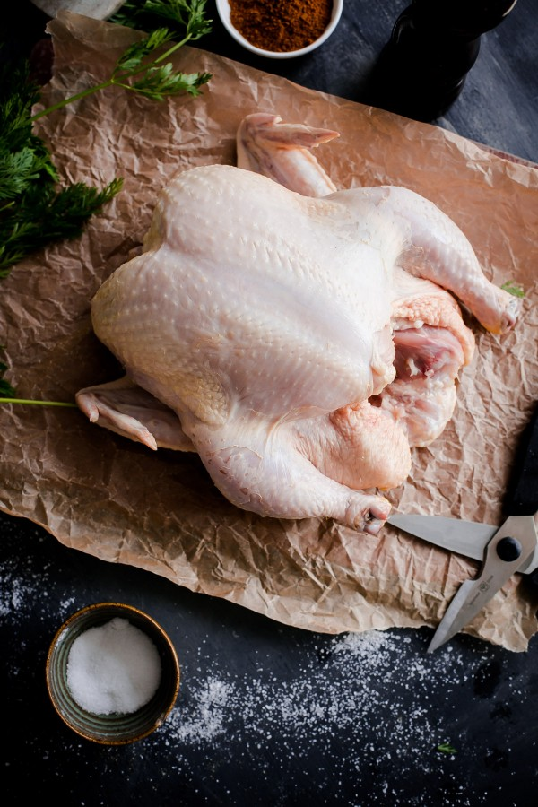 How to Spatchcock A Chicken - easy tutorial with step-by-step photos. The fastest and most consistent way to roast a chicken without trussing.