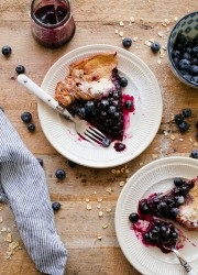 Gluten Free Dutch Baby with Blueberry Maple Syrup. This easy Dutch baby recipe is 100% whole grain and made with gluten free rolled oats!