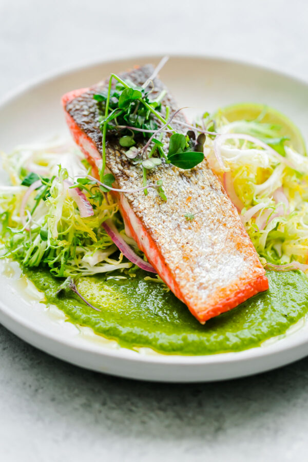 Crispy seared sockeye salmon with green chile adobo sauce and a simple frisée salad. This elegant, healthy main course can be prepared in less than 45 minutes!