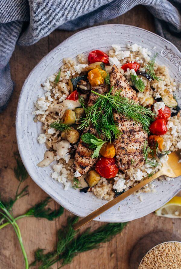 Za'atar Grilled Chicken Bulgur Bowls with Tahini Sauce - grilled chicken is paired with bulgur, roasted vegetables, feta cheese, and tahini sauce in this healthy main course.