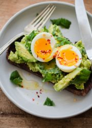 Fancy Avocado Toast - chunky avocado with lemon, chili flakes, basil - topped with a soft boiled egg!