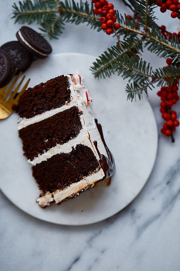 Candy Cane Crunch Cake. Peppermint chocolate layer cake filled with candy cane Swiss meringue buttercream and topped with peppermint ganache. Perfect celebration cake for the holidays!