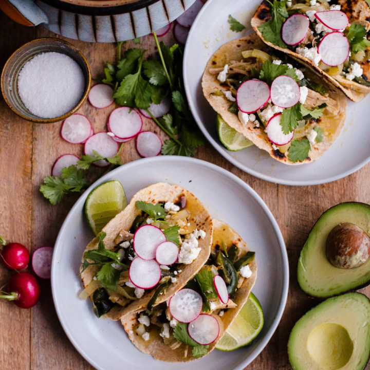 Salsa Verde Chicken Tacos. These easy chicken tacos are made with braised chicken thighs, poblano peppers, onions, and roasted tomatillo salsa!
