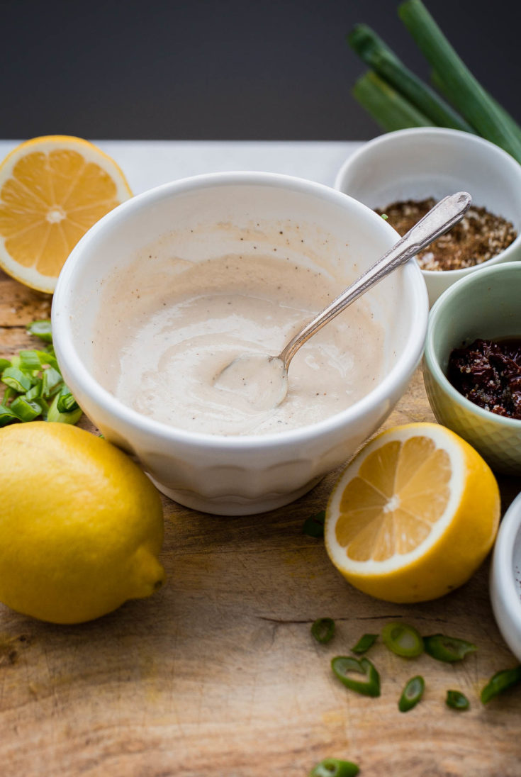 EASY Lemon Tahini Sauce - this two ingredient tahini sauce recipe can be used on grilled vegetables, chicken, meat, seafood, or thinned down and used a simple salad dressing. #tahini #tahinisauce #recipe #abeautifulplate #vegan #glutenfree #dairyfree #vegetarian