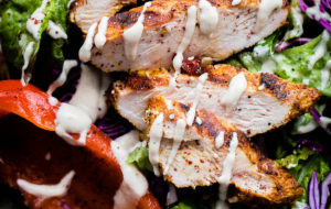 AMAZING Mediterranean Chicken Salad with Sumac Dressing. This salad is packed with flavor and is topped with tahini dressing!