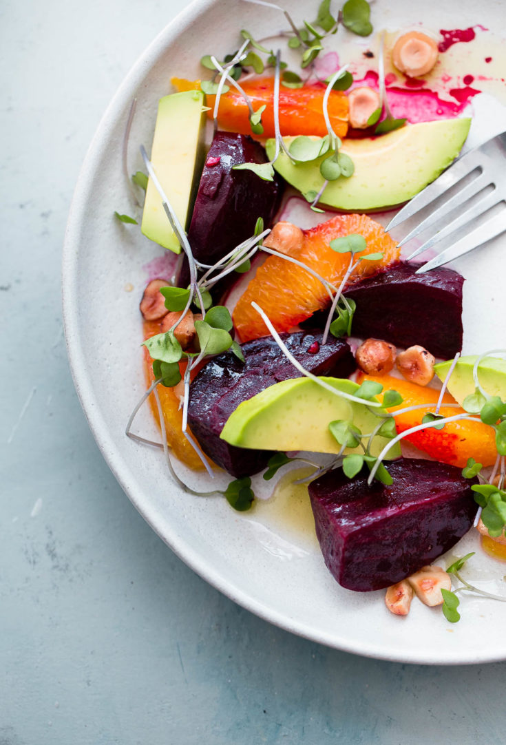 Roasted Beet Salad with Orange and Avocado. An EASY healthy salad recipe packed with healthy fats, texture, and nutrition! #salad #roastedbeets #abeautifulplate #citrus #recipe