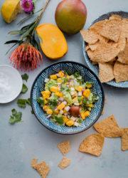 Tropical Mango Guacamole. Traditional guacamole is given a tropical twist with juicy mango and jicama! Perfect appetizer for Cinco de Mayo.