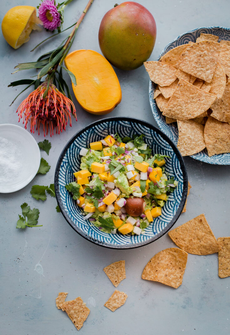 Tropical Mango Guacamole. Traditional guacamole is given a tropical twist with juicy mango and jicama! Perfect appetizer for Cinco de Mayo. #guacamole #mango #abeautifulplate #appetizer #recipe