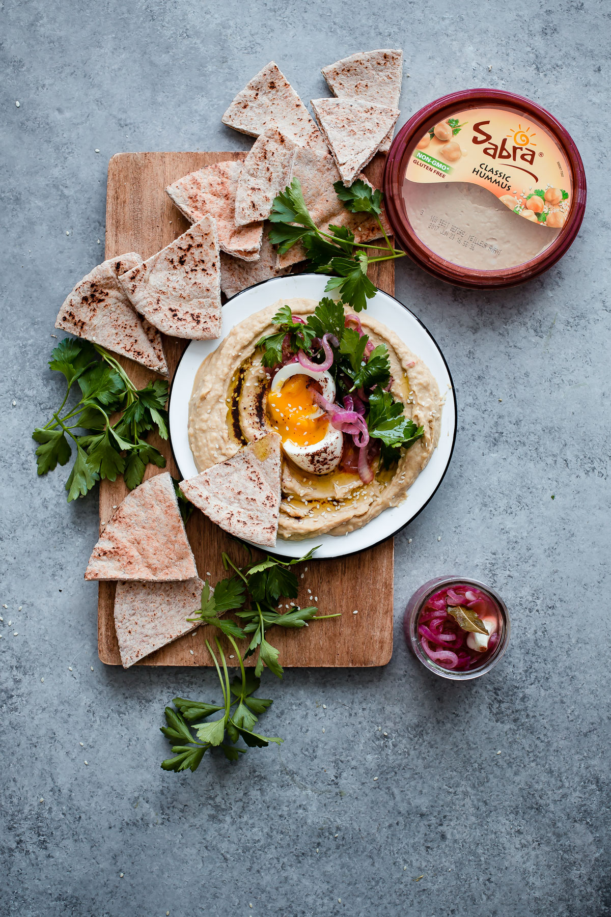 Hummus with Soft Boiled Egg, Pickled Onion, Parsley, and Sumac Oil. A delicious and filling hummus appetizer!