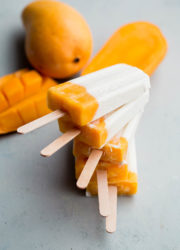 Mango Lassi Popsicles - a healthy, naturally sweetened popsicle made with Greek yogurt and fresh mango!